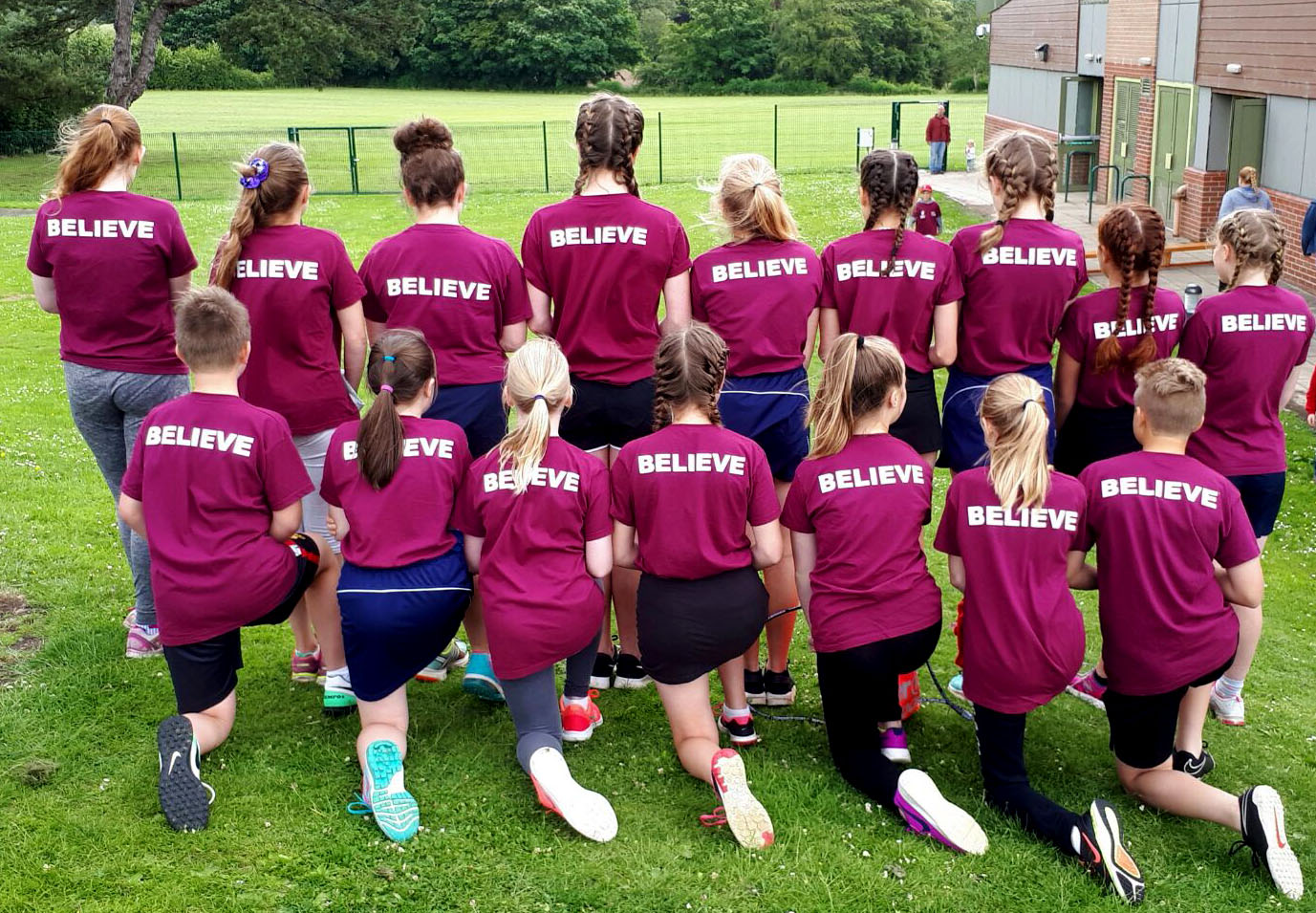 Quernmore Comets and Stars sporting their soccer and netball school t-shirts.